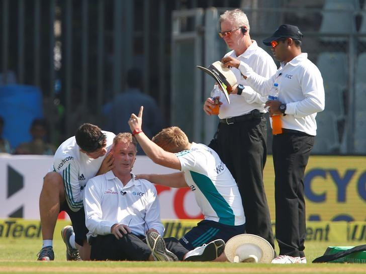 Cricket - India v England - Fourth Test cricket match - Wankhede Stadium, Mumbai, India - 8/12/16. Umpire Paul Reiffel is helped by support staff. REUTERS/Danish Siddiqui