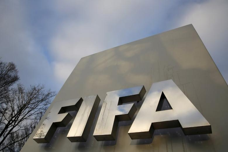 A FIFA sign is seen outside the FIFA headquarters in Zurich, Switzerland December 17, 2015. REUTERS/Ruben Sprich/File Photo