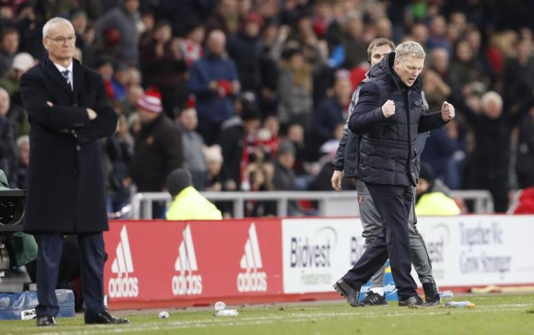 Britain Football Soccer - Sunderland v Leicester City - Premier League - The Stadium of Light - 3/12/16 Sunderland manager David Moyes celebrates after the game as Leicester City manager Claudio Ranieri looks on Action Images via Reuters / Lee Smith Livepic