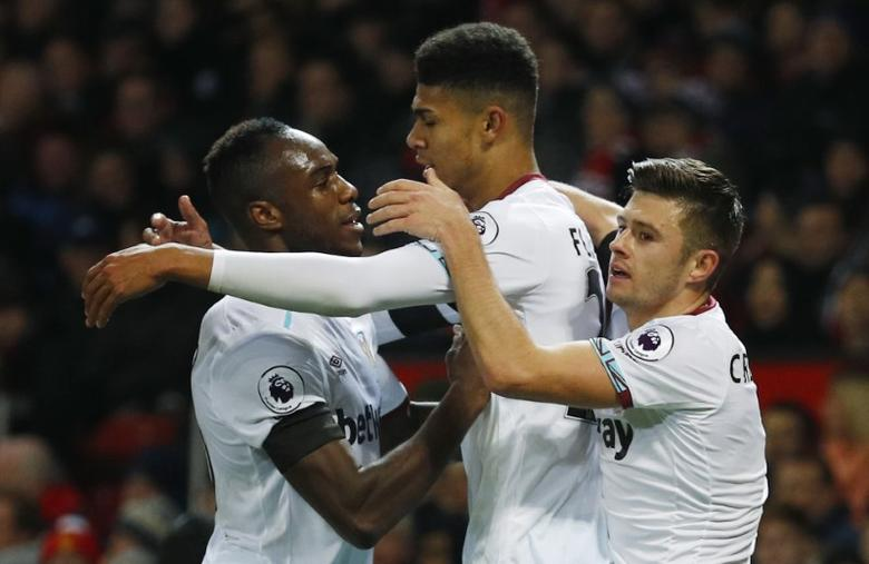 West Ham United's Ashley Fletcher celebrates scoring their first goal with Michail Antonio (L) and Aaron Cresswell. Manchester United v West Ham United - EFL Cup Quarter Final - Old Trafford - 30/11/16.  Reuters / Phil Noble Livepic