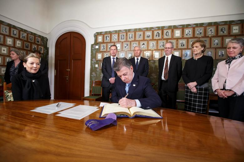 Colombian First Lady Maria Clemencia Rodriguez watches as Nobel Peace Prize laureate Colombian President Juan Manuel Santos signs a protocol in the Norwegian Nobel Institute in Oslo, Norway, December 9, 2016. NTB Scanpix/Heiko Junge via REUTERS