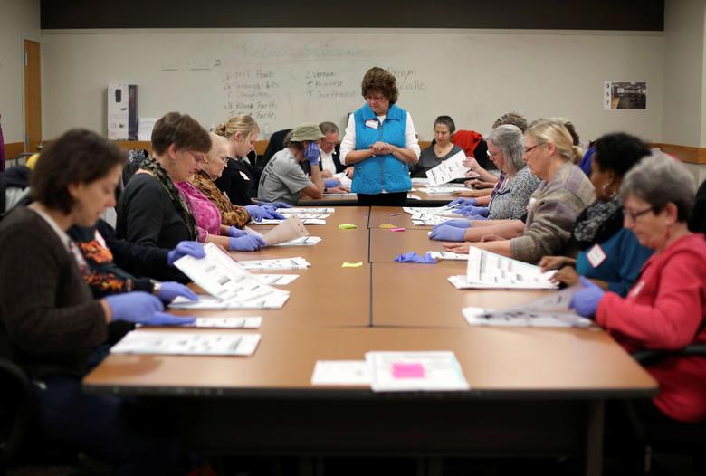 Ballots from the 2016 U.S. presidential election are recounted, following a request by the Green Party, in Madison, Wisconsin, U.S. December 2, 2016.  REUTERS/Ben Brewer/File Photo