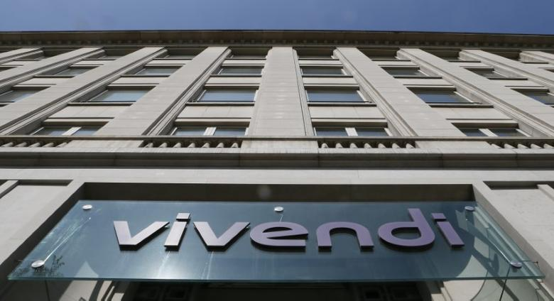 A logo is seen over the main entrance of the entertainment-to-telecoms conglomerate Vivendi's headquarters in Paris April 8, 2015. French media conglomerate Vivendi is looking at a possible acquisition of pay-TV group Sky, as one of several options to expand the reach of its own TV group Canal Plus, three sources familiar with the matter said. REUTERS/Gonzalo Fuentes