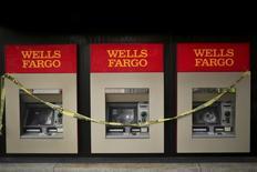 Damaged ATM machines are shown at a Wells Fargo bank building on Shattuck Avenue, in Berkeley, California December 8, 2014. REUTERS/Robert Galbraith