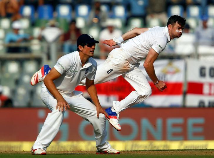 Cricket - India v England - Fourth Test cricket match - Wankhede Stadium, Mumbai, India - 9/12/16. England's James Anderson (R) bowls as Alastair Cook looks on. REUTERS/Danish Siddiqui