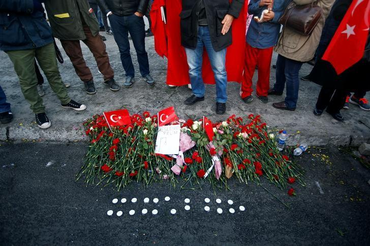 Flowers are seen at the scene of Saturday's blasts in Istanbul, Turkey December 11, 2016. REUTERS/Osman Orsal