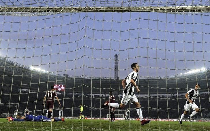 Football - Soccer - Torino v Juventus - Italian Serie A - Olympic Stadium, Turin, Italy - 11/12/2016.  Juventus' Miralem Pjanic celebrates after scoring third goal.     REUTERS/Giorgio Perottino