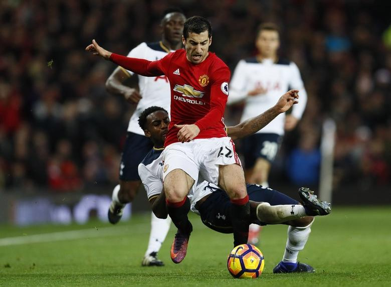 Football Soccer Britain - Manchester United v Tottenham Hotspur - Premier League - Old Trafford - 11/12/16 Manchester United's Henrikh Mkhitaryan is fouled by Tottenham's Danny Rose  Action Images via Reuters / Jason Cairnduff Livepic