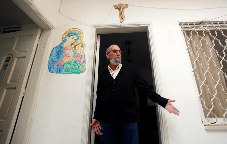 Christian artist and sculptor Naser Jeldha gestures outside his studio in Gaza City December 4, 2016. Picture taken December 4, 2016. REUTERS/Suhaib Salem