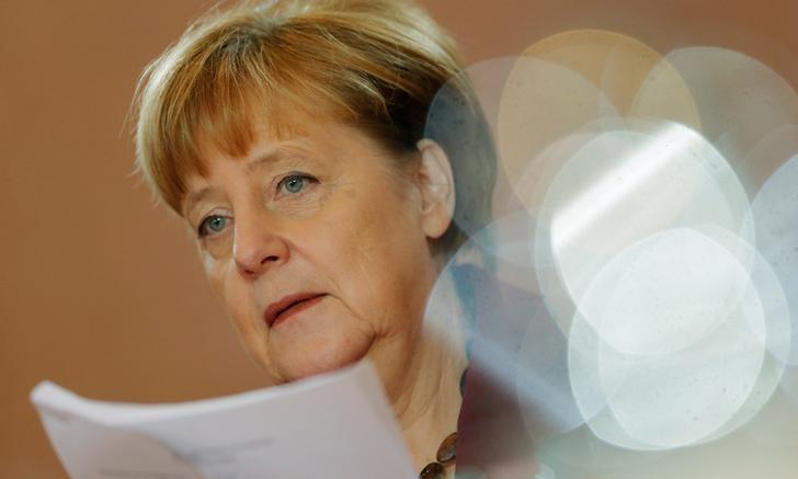 German Chancellor Angela Merkel attends the weekly cabinet meeting at the chancellery in Berlin, Germany, December 9, 2016. REUTERS/Hannibal Hanschke