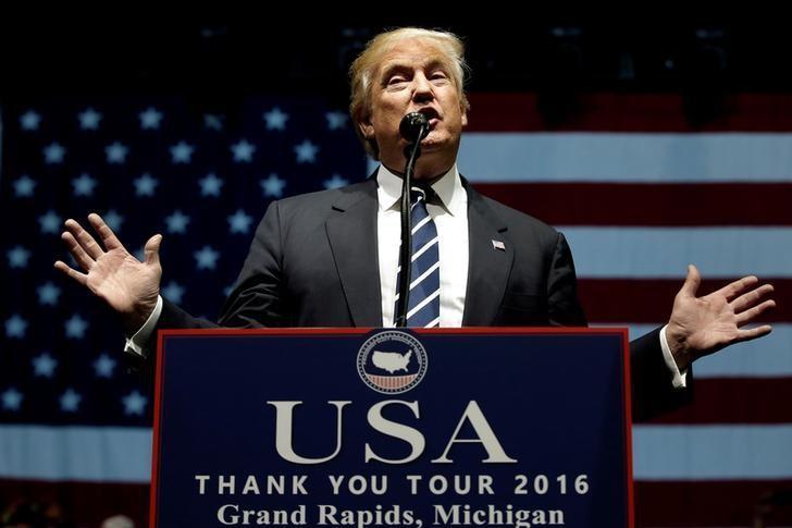 U.S. President-elect Donald Trump speaks at a ''Thank You USA'' tour rally in Grand Rapids, Michigan, U.S. December 9, 2016.  REUTERS/Mike Segar