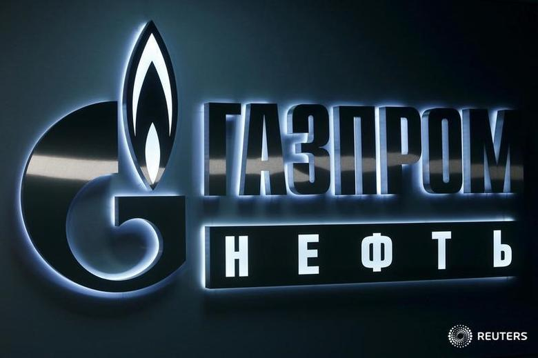 A sign displaying the logo of Russia's Gazprom Neft oil company is seen at the company's office in the West Siberian city of Khanty-Mansiysk, Russia, January 28, 2016. REUTERS/Sergei Karpukhin/File Photo
