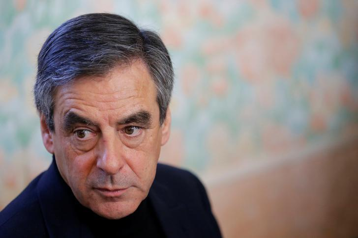 Francois Fillon, member of Les Republicains political party and 2017 presidential candidate of the French centre-right, attends a lunch during a visit in Chantenay-Villedieu, western France, December 1, 2016. REUTERS/Stephane Mahe