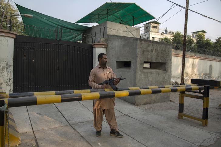 A security guard from the Ahmadi community stands outside the Ahmadi's Batul Noor mosque in Lahore December 10, 2013. REUTERS/Zohra Bensemra