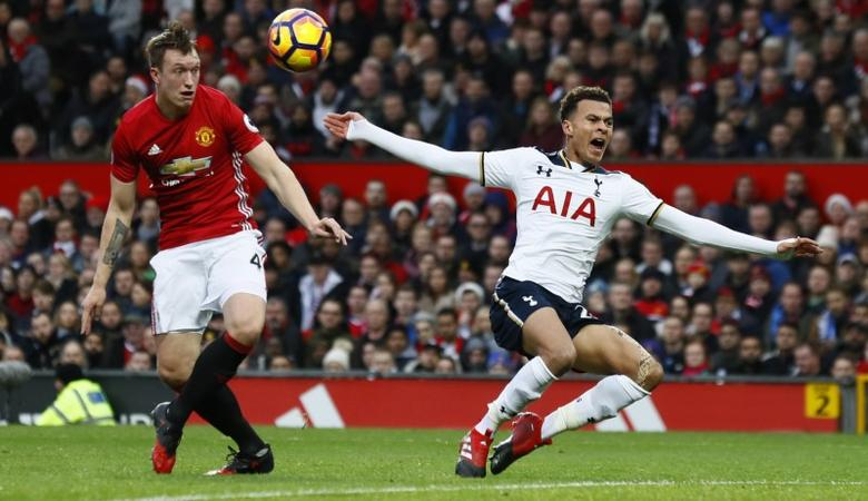 Tottenham's Dele Alli goes down after a challenge by Manchester United's Phil Jones. Premier League - Old Trafford - 11/12/16.   Action Images via Reuters / Jason Cairnduff Livepic