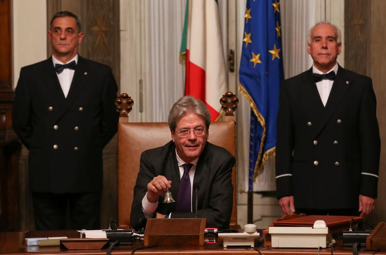 Newly appointed Italian Prime Minister Paolo Gentiloni rings the bell during his first cabinet meeting at Chigi Palace in Rome, Italy. REUTERS/Alessandro Bianchi
