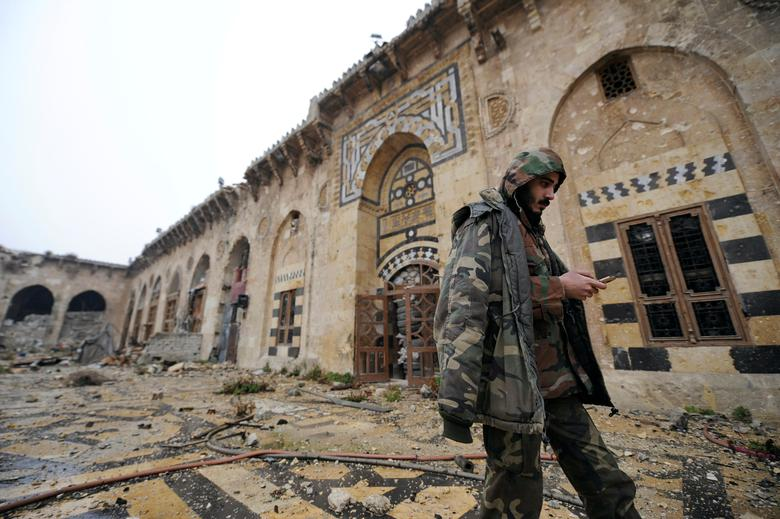 A member of forces loyal to Syria's President Bashar al-Assad walks inside the Umayyad mosque, in the government-controlled area of Aleppo, during a media tour, Syria December 13, 2016. REUTERS/Omar Sanadiki