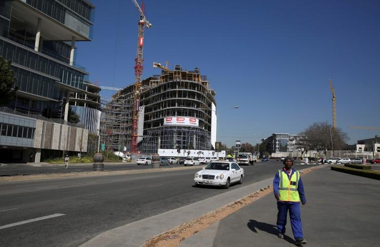 A worker walks away from a construction site in Sandton outside Johannesburg, South Africa July 12,2016. REUTERS/Siphiwe Sibeko