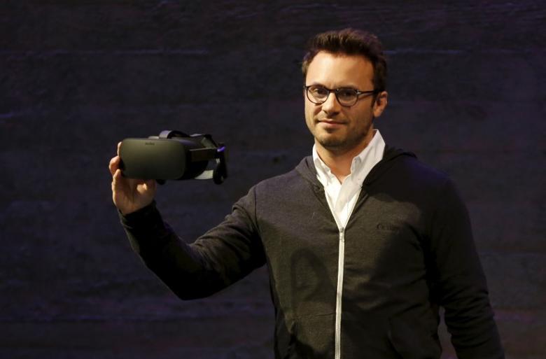 Brendan Iribe displays a virtual reality headset during an event in San Francisco, California June 11, 2015.  REUTERS/Robert Galbraith