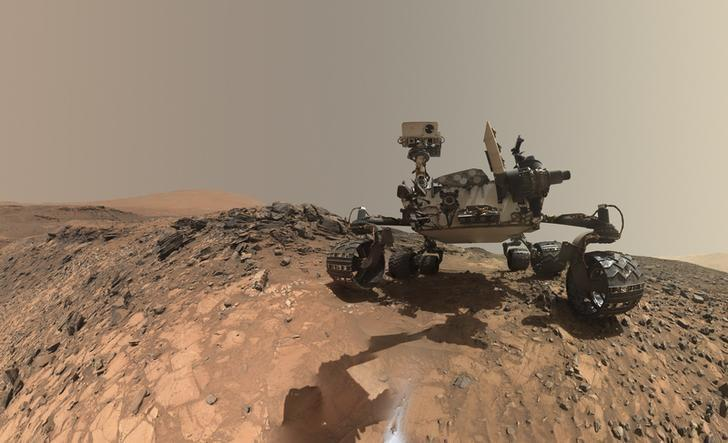 A low-angle self-portrait of NASA's Curiosity Mars rover showing the vehicle at the site from which it reached down to drill into a rock target call ''Buckskin'' is show in this handout photo taken August 5, 2015 and provided by NASA October 8, 2015. REUTERS/NASA/JPL-Caltech/MSSS/Handout via Reuters /Files