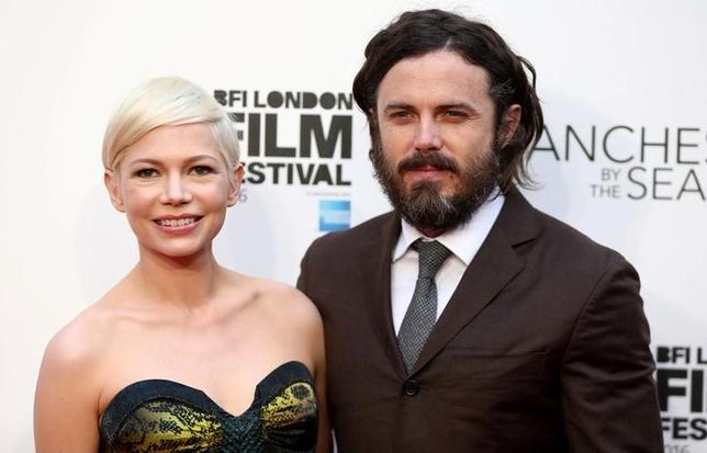 Actors Michelle Williams (L) and Casey Affleck pose for photographers at a Gala screening of their film ''Manchester by the Sea'' at the 60th BFI London Film Festival in London, Britain October 8, 2016. REUTERS/Neil Hall/Files