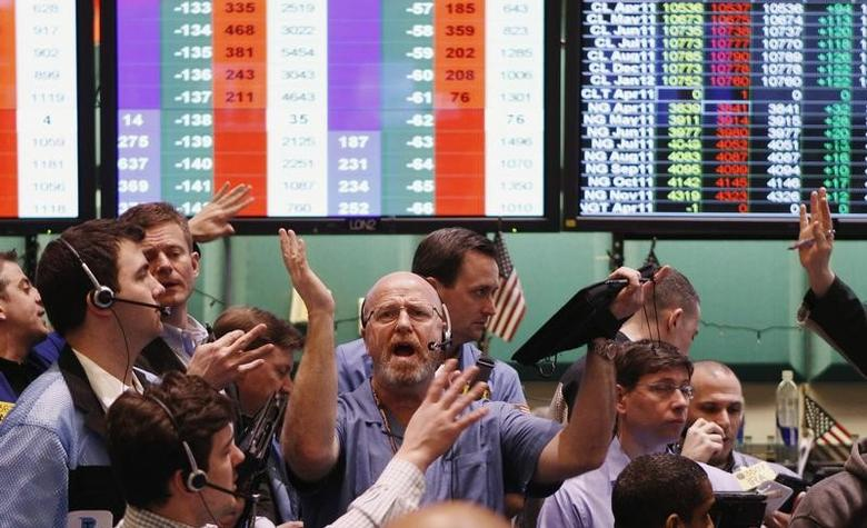 Traders gesture at each other while working in the crude oil and natural gas options pit on the floor of the New York Mercantile Exchange March 7, 2011.   REUTERS/Lucas Jackson