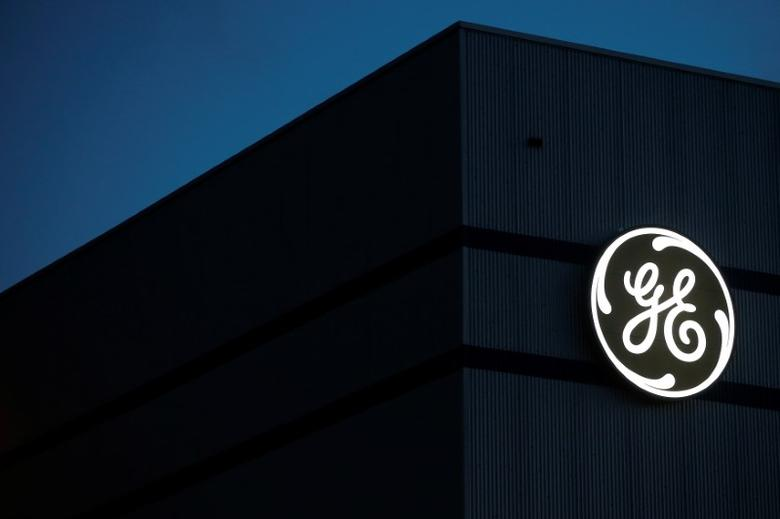 The General Electric logo is pictured on the General Electric offshore wind turbine plant in Montoir-de-Bretagne, near Saint-Nazaire, western France, November 21, 2016. REUTERS/Stephane Mahe - RTSSOBY