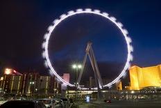 An evening view of the 550-foot-tall High Roller observation wheel after opening in Las Vegas, Nevada March 31, 2014. The observation wheel, the tallest in the world, is part of the Linq project, a $550 million development by Caesars Entertainment Corp. REUTERS/Las Vegas Sun/Steve Marcus