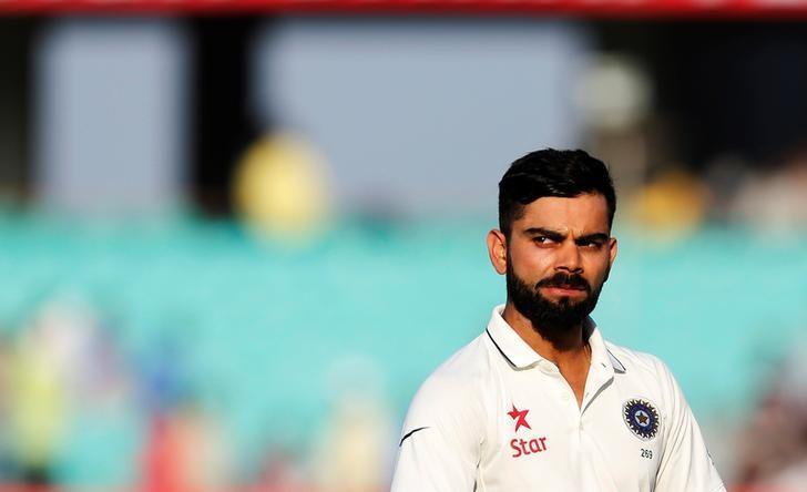 Cricket - India v England - First Test cricket match - Saurashtra Cricket Association Stadium, Rajkot, India - 13/11/16. India's captain Virat Kohli walks off the field after the end of last day's play. REUTERS/Amit Dave