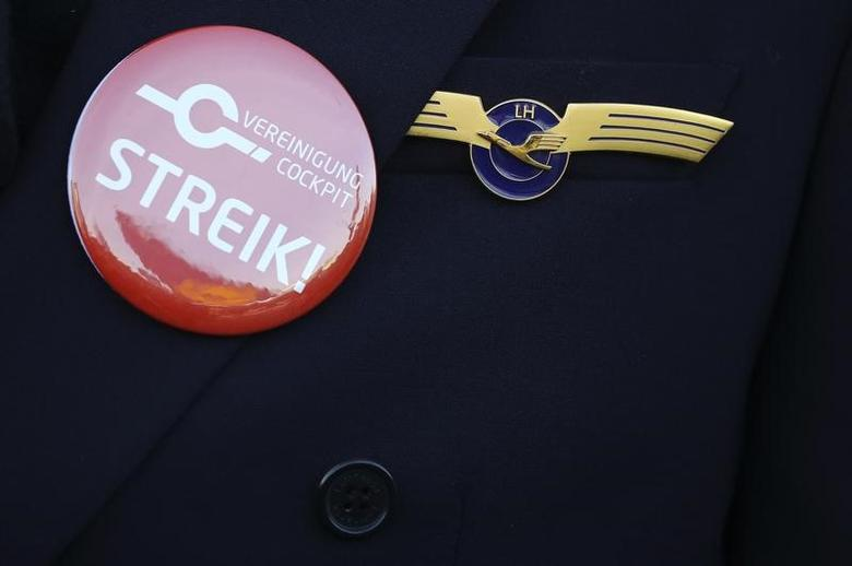 A pilot of German airline Lufthansa sports a button reading ''we are on strike'' on his uniform as he takes part in a demonstration during a strike of the German airline Lufthansa pilots at Frankfurt airport, Germany, November 30, 2016.     REUTERS/Kai Pfaffenbach