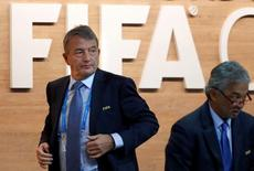 Wolfgang Niersbach walks out of the stage during the Extraordinary FIFA Congress in Zurich, Switzerland February 26, 2016. REUTERS/Arnd Wiegmann/File Photo