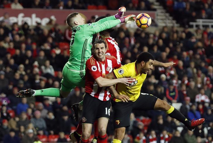 Britain Football Soccer - Sunderland v Watford - Premier League - Stadium of Light - 17/12/16 Sunderland's Jordan Pickford and John O'Shea in action with Watford's Troy Deeney Action Images via Reuters / Lee Smith Livepic
