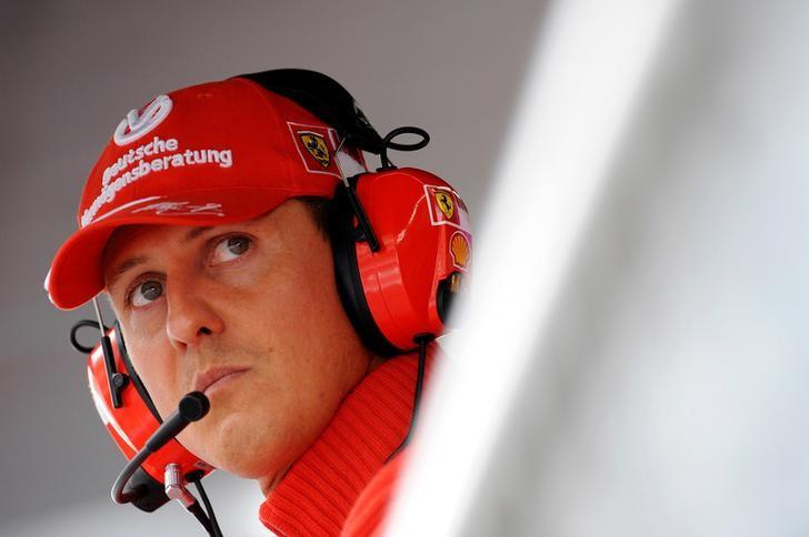 Former Ferrari driver Michael Schumacher of Germany looks on during the qualifying session for the Italian F1 Grand Prix race at the Monza racetrack in Monza, near Milan, in this September 13, 2008 file photo.   REUTERS/Alessandro Bianchi/File Photo