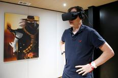 A man plays a video game with the Oculus Rift VR headset at the E3 Electronic Expo in Los Angeles, California, U.S. on June 14, 2016. REUTERS/Lucy Nicholson/File Photo