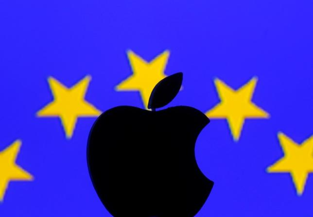 A 3D printed Apple logo is seen in front of a displayed European Union flag in this illustration taken September 2, 2016. REUTERS/Dado Ruvic/Illustration