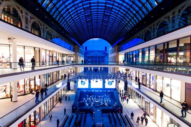 A general view shows the atrium of the Mall of Berlin shopping centre during its opening night in Berlin, Germany, September 24, 2014. REUTERS/Thomas Peter/File Photo