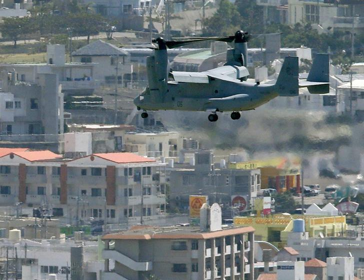 An MV-22 Osprey aircraft of the U.S. Marine Corps flies to land at the Marines' Futenma Air Station in Ginowan, Okinawa Prefecture, in this photo taken by Kyodo October 1, 2012. REUTERS/Kyodo/Files