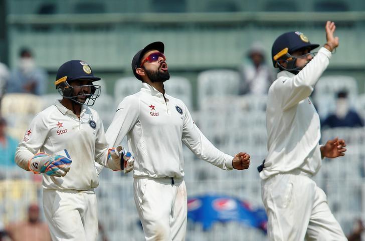 Cricket - India v England - Fifth Test cricket match - M A Chidambaram Stadium, Chennai, India - 20/12/16. India's captain Virat Kohli (C) celebrates with team mates the dismissal of England's Keaton Jennings. REUTERS/Danish Siddiqui