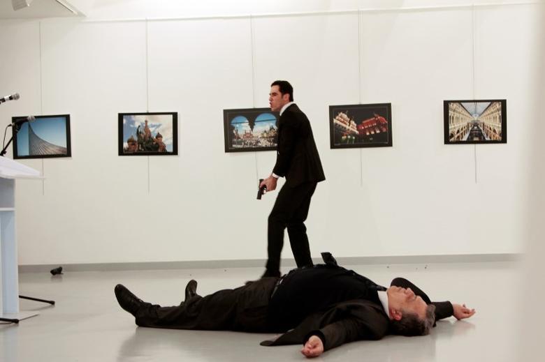 Russian Ambassador to Turkey Andrei Karlov lies on the ground after he was shot by Mevlut Mert Altintas at an art gallery in Ankara, Turkey, December 19, 2016. Hasim Kilic/Hurriyet via REUTERS
