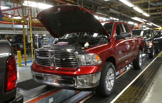 FILE PHOTO:  An assembly line with 2014 Ram 1500 pickup trucks is seen at the Warren Truck Plant in Warren, Michigan, U.S. on September 25, 2014. REUTERS/Rebecca Cook/File Photo