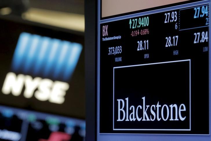 The ticker and trading information for Blackstone Group is displayed at the post where it is traded on the floor of the New York Stock Exchange (NYSE) April 4, 2016. REUTERS/Brendan McDermid  - RTSDKHE