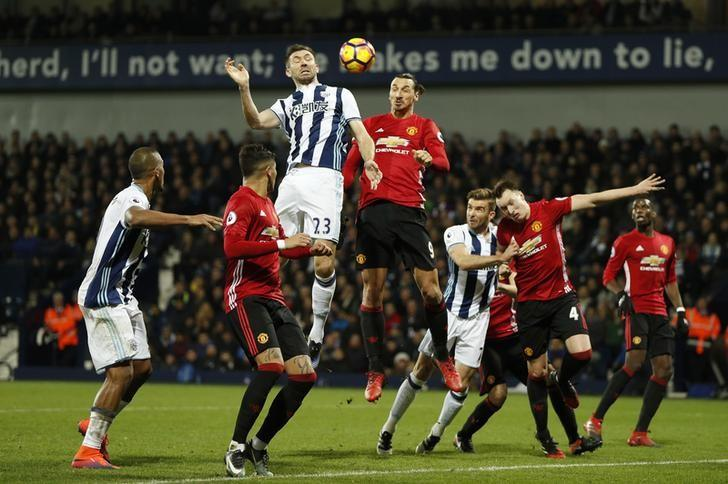 Britain Football Soccer - West Bromwich Albion v Manchester United - Premier League - The Hawthorns - 17/12/16 West Bromwich Albion's Gareth McAuley in action with Manchester United's Zlatan Ibrahimovic  Action Images via Reuters / John Sibley Livepic