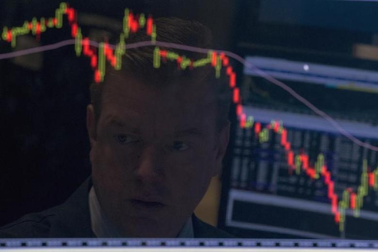 A specialist trader is reflected on his screen on the floor of the New York Stock Exchange August 25, 2015. REUTERS/Brendan McDermid