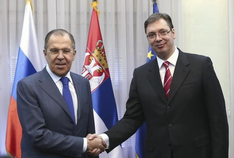 Serbia's Prime Minister Aleksandar Vucic (R) welcomes Russia's Foreign Minister Sergei Lavrov in Belgrade, Serbia,  December 12, 2016.  REUTERS/Djordje Kojadinovic