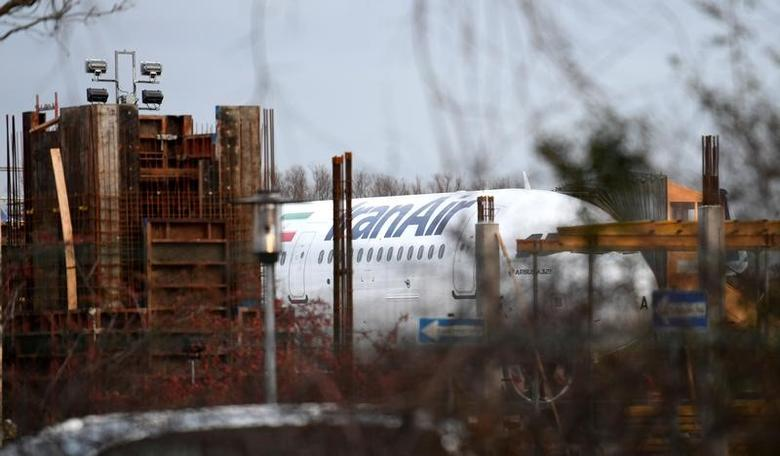 An Airbus A321 with the Iranian flag and description ''The airline of the Islamic Republic of Iran'' is parked at the Airbus facility in Hamburg Finkenwerder, Germany, December 19, 2016.        REUTERS/Fabian Bimmer