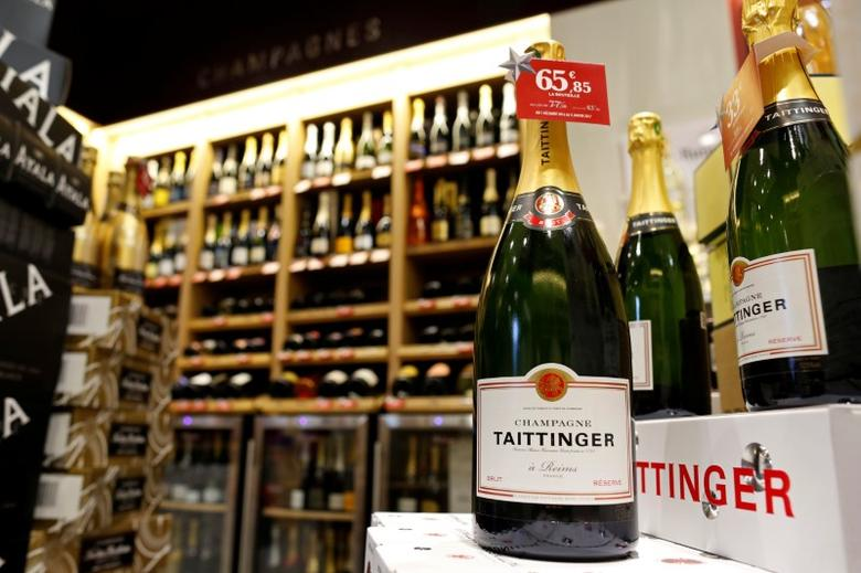 Bottles of Taittinger champagne are displayed December 21, 2016 at a Nicolas French wine specialist store in Paris, France.  Picture taken December 21, 2016.  REUTERS/Charles Platiau