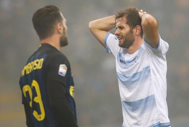 Football Soccer - Inter Milan v Lazio - Italian Serie A - San Siro Stadium, Milan, Italy - 21/12/2016. Lazio's Senad Lulic (R) reacts during the game. REUTERS/Alessandro Garofalo