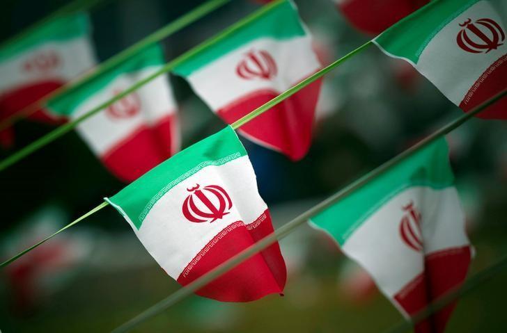 Iran's national flags are seen on a square in Tehran, Iran February 10, 2012. REUTERS/Morteza Nikoubazl/Files