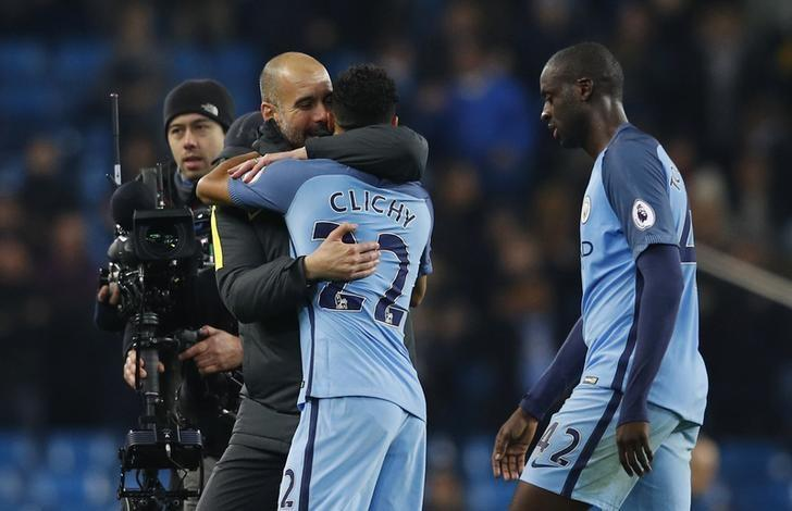 Britain Football Soccer - Manchester City v Arsenal - Premier League - Etihad Stadium - 18/12/16 Manchester City manager Pep Guardiola celebrates with Gael Clichy at the end of the match  Reuters / Phil Noble Livepic EDITORIAL USE ONLY. No use with unauthorized audio, video, data, fixture lists, club/league logos or ''live'' services. Online in-match use limited to 45 images, no video emulation. No use in betting, games or single club/league/player publications. Please contact your account representative for further details.