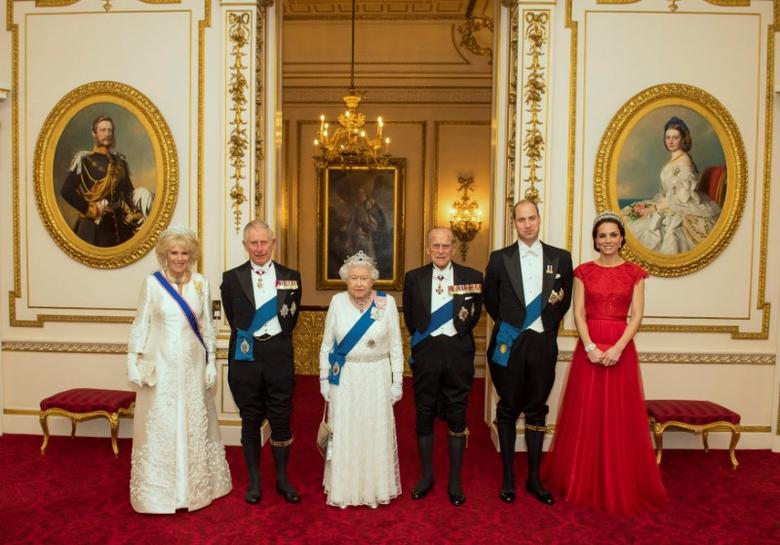 The Duchess of Cornwall, the Prince of Wales, Queen Elizabeth II, the Duke of Edinburgh, and Duke and Duchess of Cambridge (L-R) arrive for the annual evening reception for members of the Diplomatic Corps at Buckingham Palace in London, Britain December 8, 2016.  REUTERS/Dominic Lipinski/Pool/File Photo
